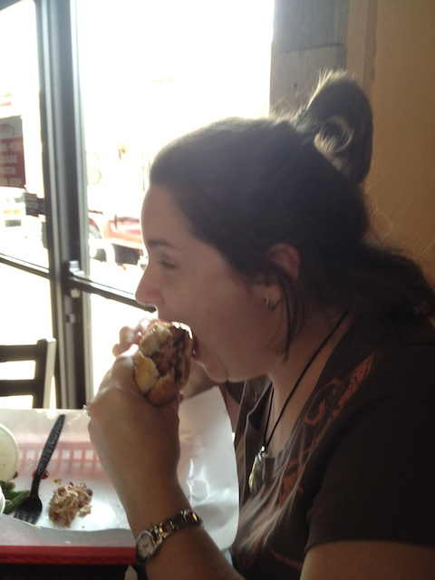 Heather enjoying a pulled pork sandwich
